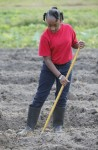 Jamyah Moore works to remove the weeds in the garden during the after school program.