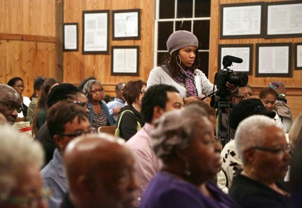 Ski Dauphiney runs the first camera during a civil rights symposium at the Penn Center National Historic Landmark District on St. Helena Island. Dauphiney worked on the crew and in post-production for the project.