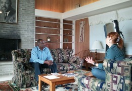 Denise McGill interviews Walter Mack just before he retired as executive director of the Penn Center National Historic Landmark District. The interview takes place in a cottage built for Dr. Martin Luther King, a frequent visitor to the Penn Center. Unfortunately, King was killed before he could stay in the building.