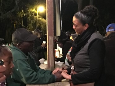 """Victoria Smalls (right) and Ed """"Lee Man"""" Atkins hold hands while talking during the Heritage Day Fish Fry."""