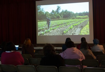"""Denise McGill watches """"The Gullah Project"""" with an audience in Darrah Hall."""